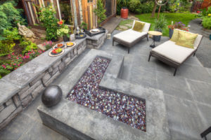 Contemporary fire pit with seat walls