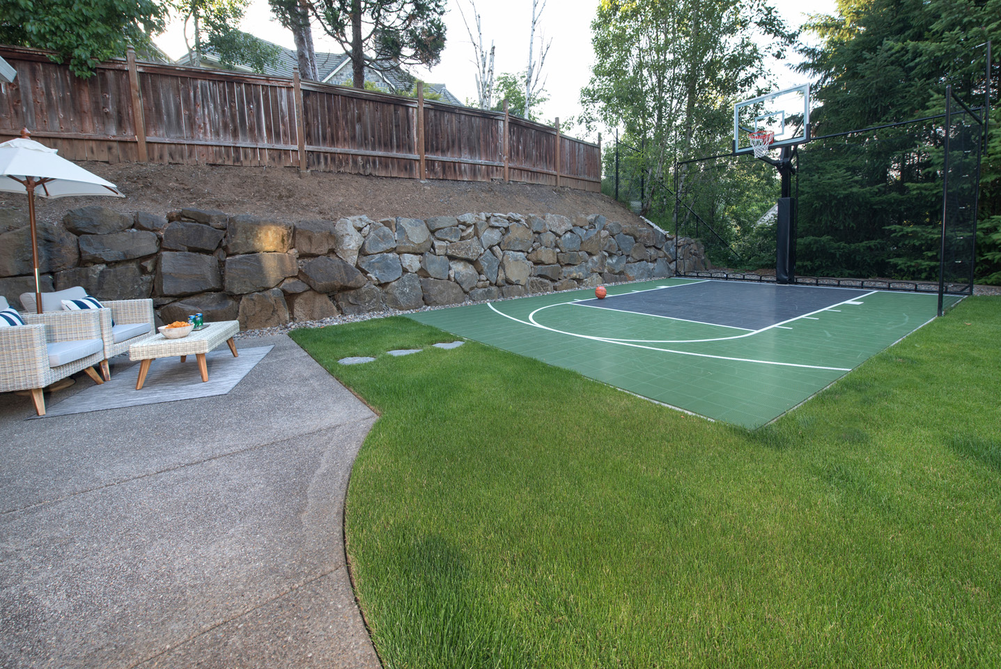 Basketball court with spectator lounge area