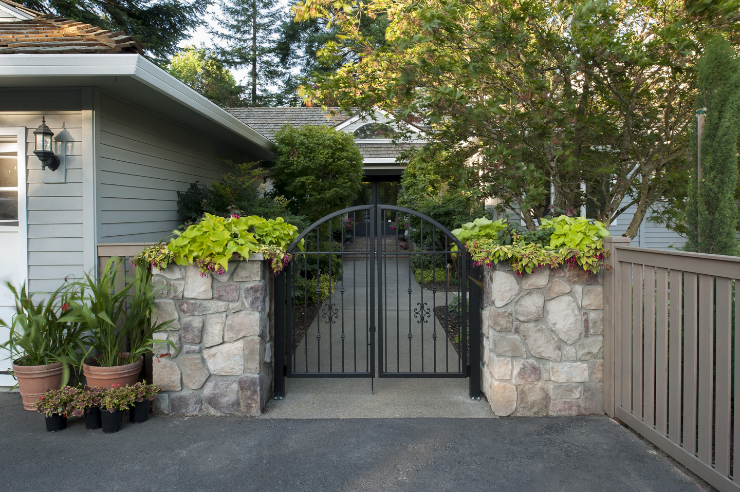 Front gate with column stone planters