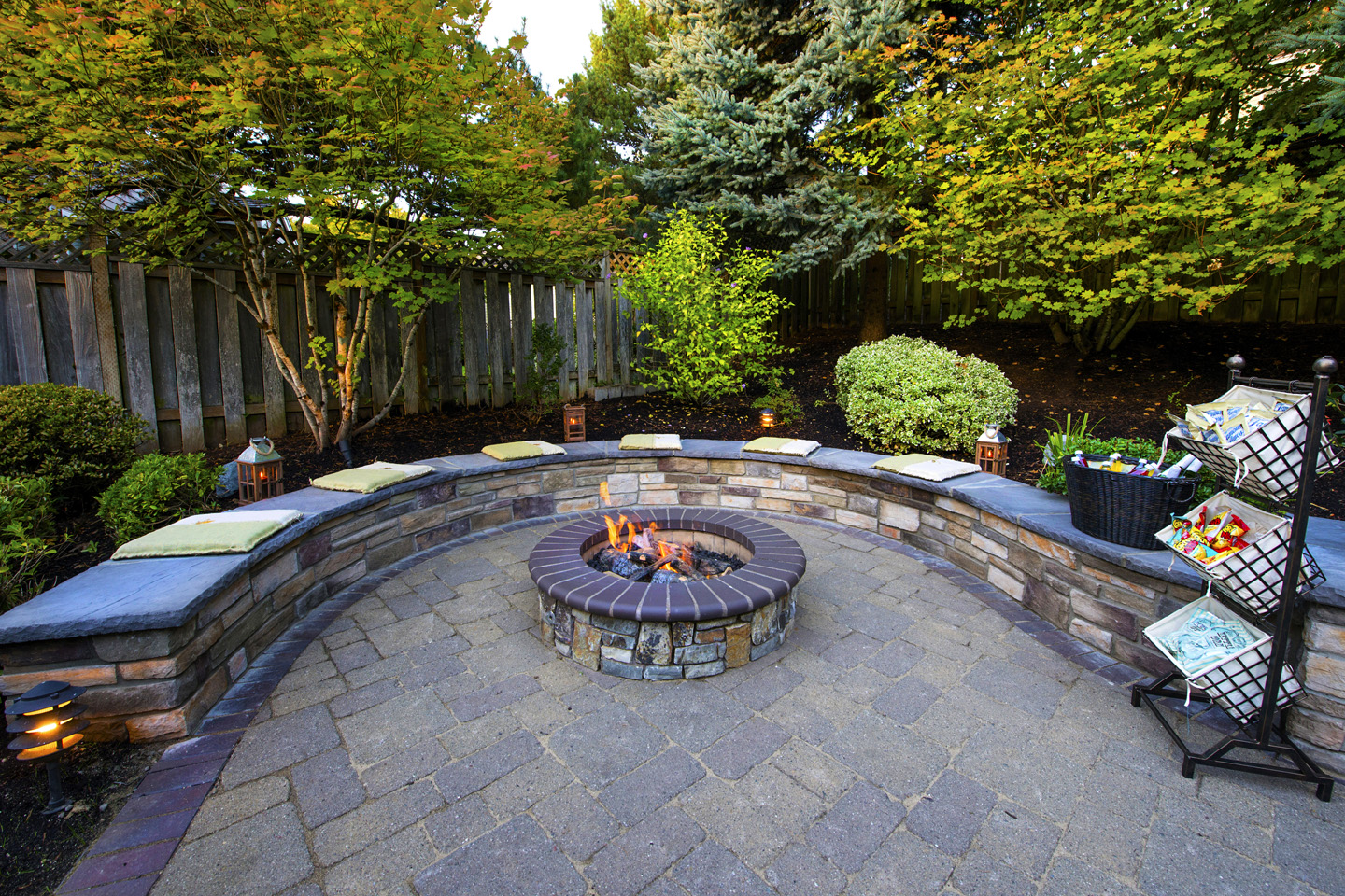 Firepit with Seatwall in sloped backyard