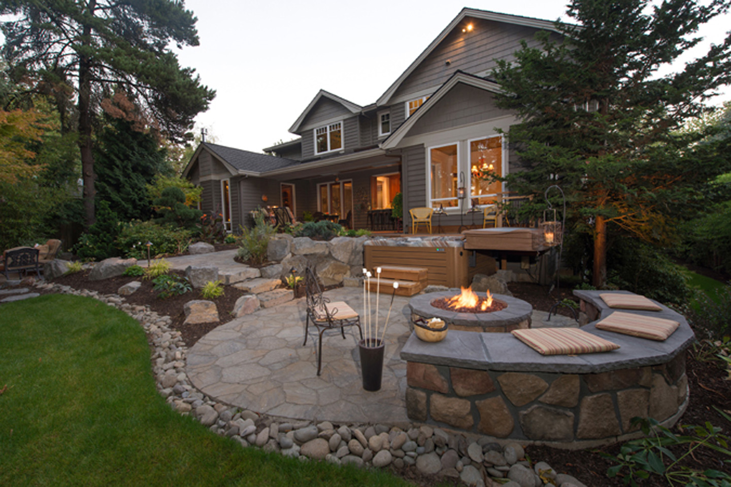 Firepit with Seatwall - sloped backyard