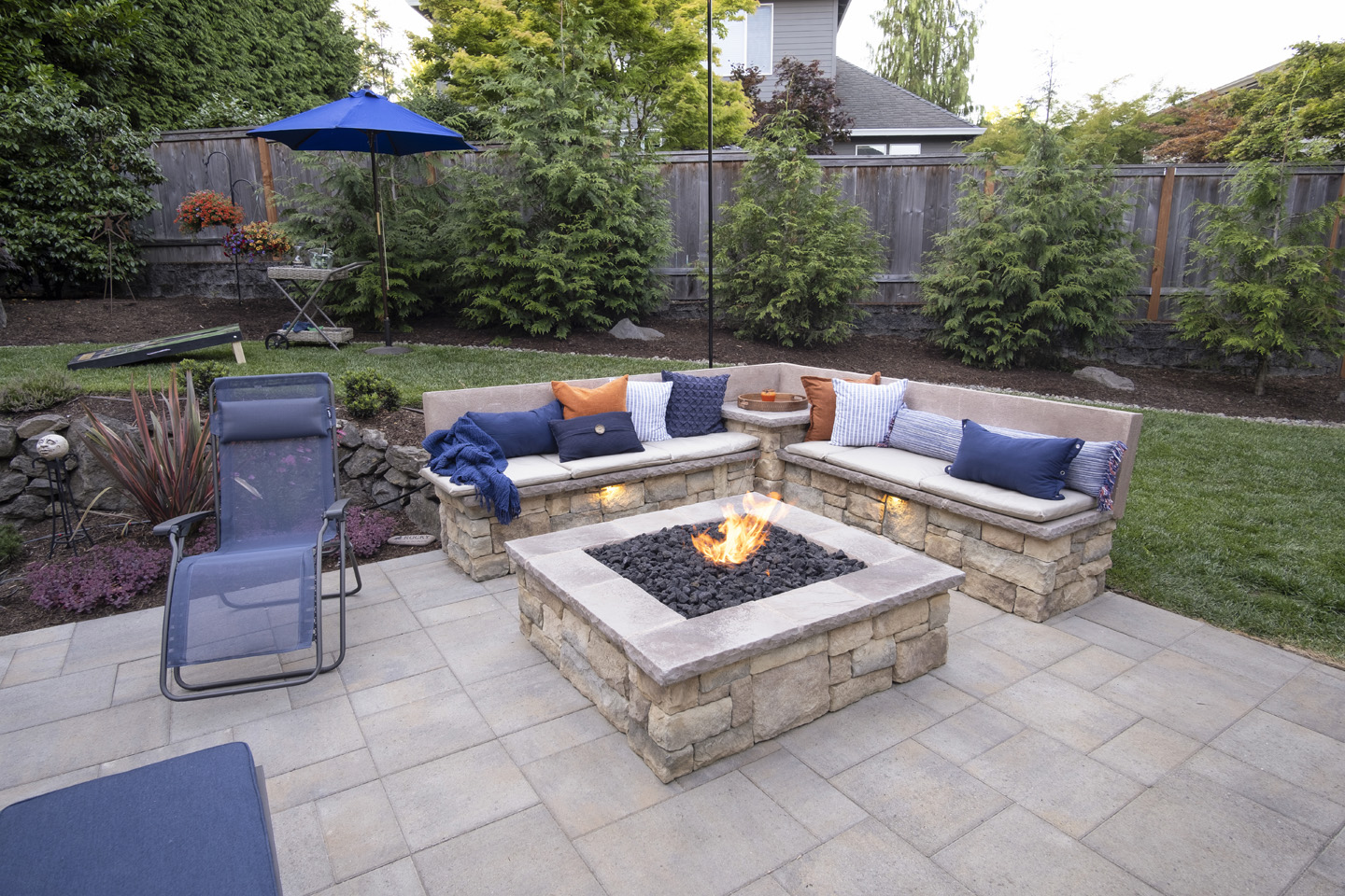 Sloped Backyard with Firepit Seatwall with Seatbacks