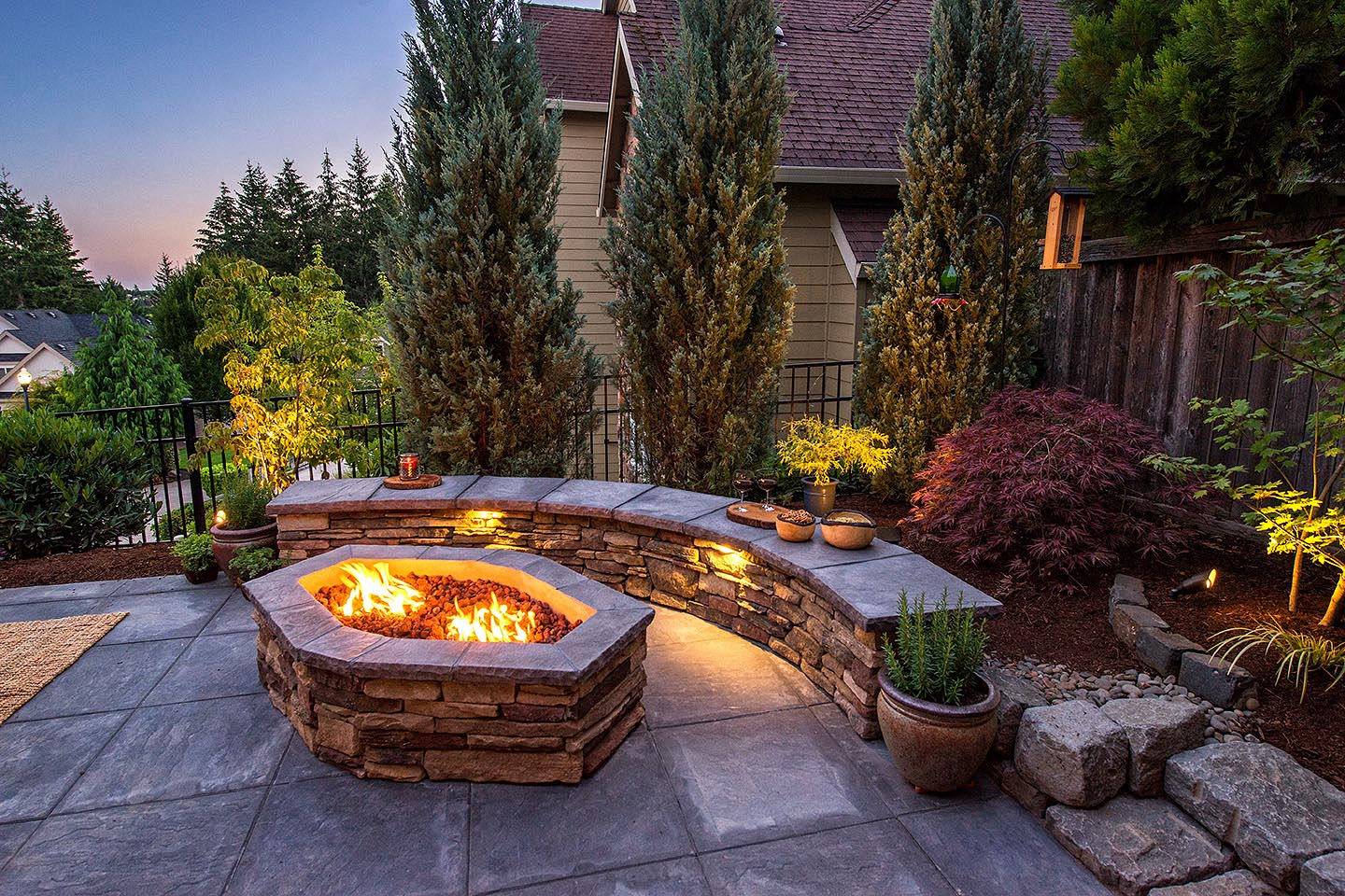 Sloped Backyard with Firepit Seatwal