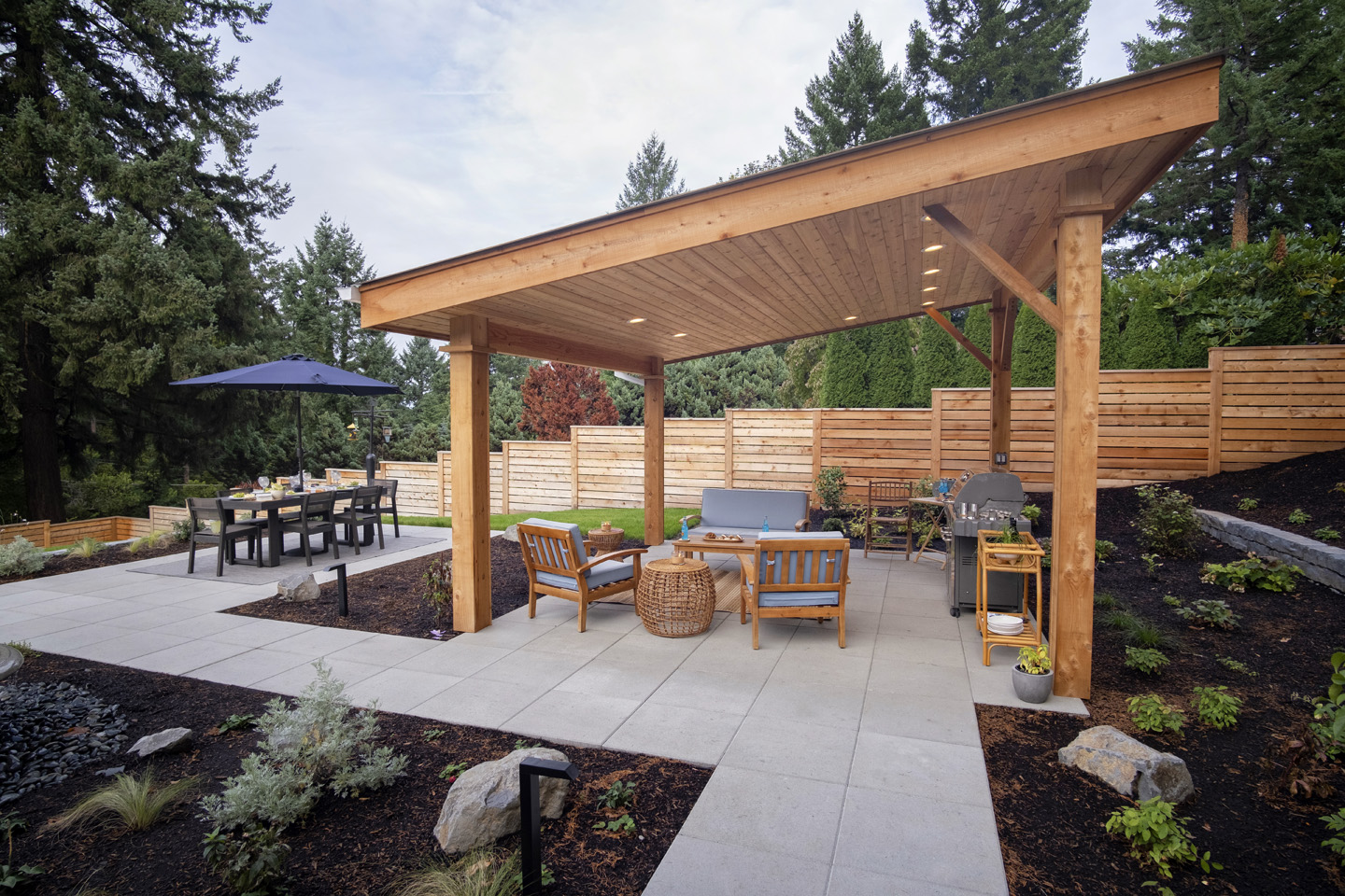 Lean-to covered structure in outdoor living